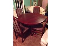 Round to oval extending dining table and 6 chairs