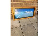 Wooden framed sea picture.
