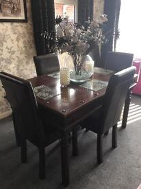 Solid dark wood 4 Seater table and brown leather chairs