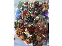 A huge selection of beads of different sizes, shapes and colours.