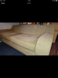 Two cream /beige large two seater sofas and poufee