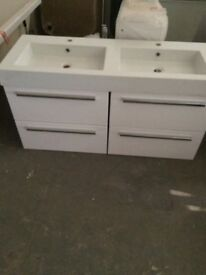 Double wash hand basin and drawer unit.