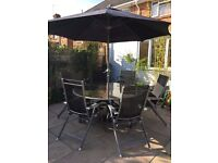 6 seater patio table, chairs and parasol (duplicate table included)