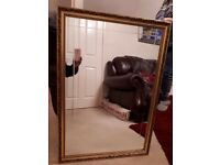 Large gold coloured mirror