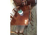 Vintage twin pedestal table with six recently reupholstered vintage chairs.