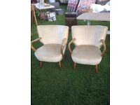 A pair of vintage 1960s cocktail chairs