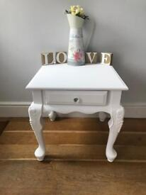 Decorative solid table with drawer