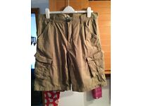 Mens green khaki shorts. Size L
