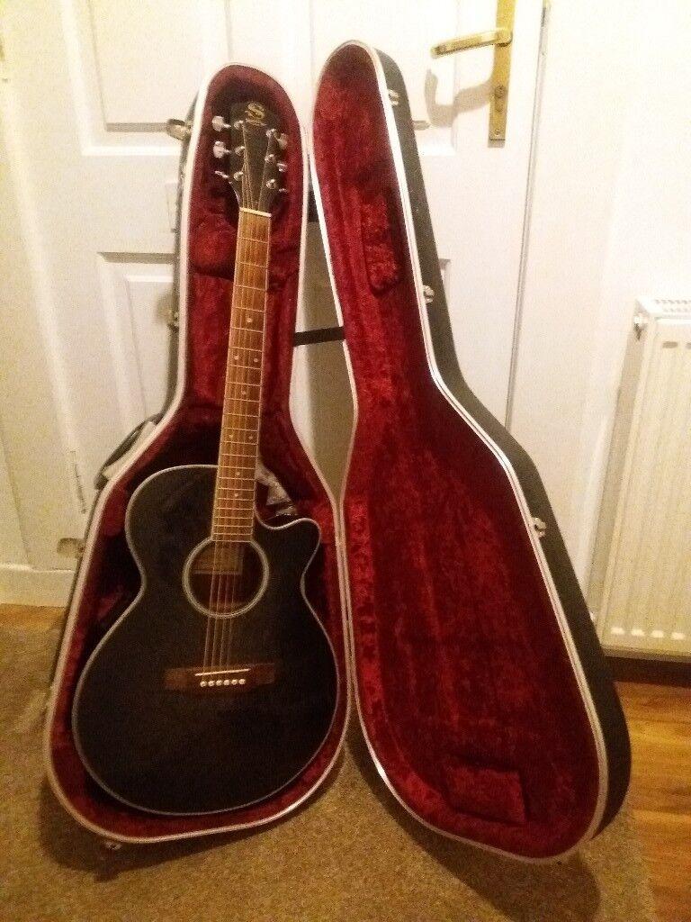Sepia Crue guitar and case.