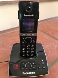 Panasonic landline phone. Cordless. Answer machine. Charging base. Black.