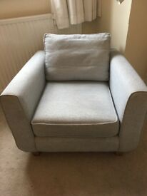 Small, comfortable armchair for sale.