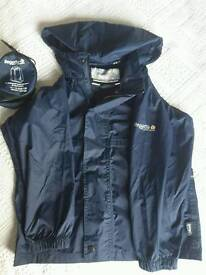 Regatta child's navy waterproof jacket / pack-a-mac & bag age 7-8