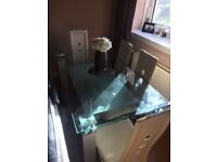 Glass table with cream leather chairs x4