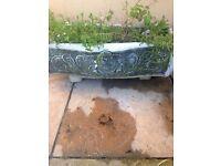 Large solid cherub trough planter on feet