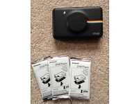 Polaroid snap digital and instant print camera. With 3 x10 sheets of zinc sticky-back paper.