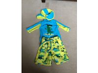 Boys swim suit and hat 3-6 months Worn once for 10minutes! M&S clothing