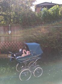 The Pram is in great condition, is collapsable, and has back support, apron and basket.