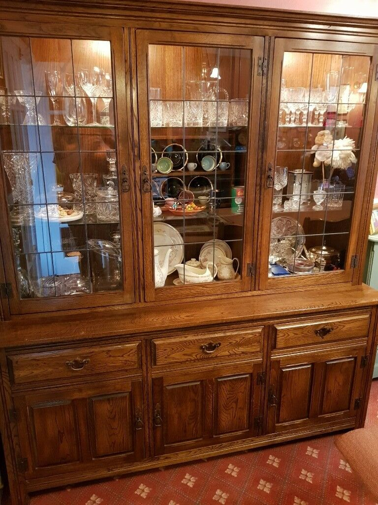 Solid Oak Dining Room Cabinet With Glass Doors Offers Welcome