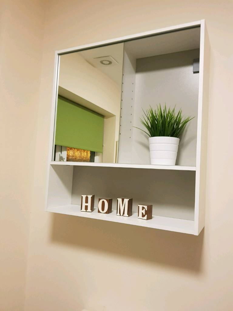 White bathroom cabinet with sliding mirror