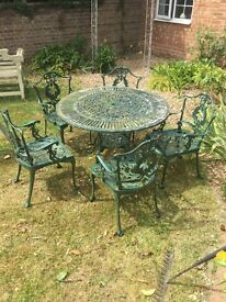 Cast metal garden table and chairs