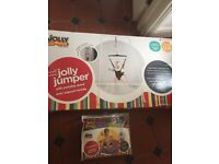 Jolly Jumper with portable stand & musical mat for sale