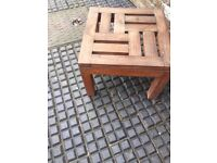 Small low solid Teak garden tables perfect next to deckchairs or sun loungers