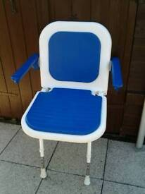 'AK' SHOWER SEAT WITH LEGS AND ARM SUPPORTS.