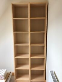 A pair of Ikea billy bookcases