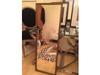 Tall, antique style gold mirror