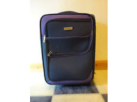 1 x Blue Wheeled Suitcase, used, better suited for storage rather than travel