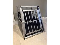 Dog transport cage with sloping front.