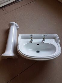 White wash basin and pedestal.