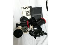 Assorted Darkroom Equipment. Developing Tanks, reels, Illford Papee.