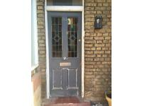 Old front door with stained glass panels & keys for locks