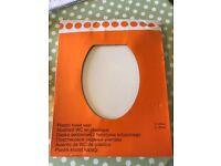 Plastic toilet seat - new still in box