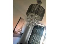 Grey chandelier light from Next