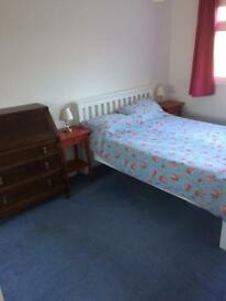 Spacious furnished double room in quiet home with friendly couple