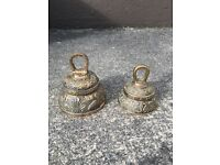 2 brass bells in good condition with an intricate design.