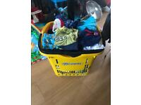 Full basket of boys clothes