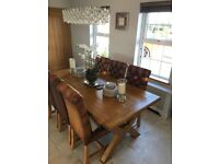 Oak kitchen table and 6 leather chairs