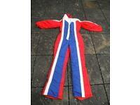 Size 10 red, white and blue ski suit unused