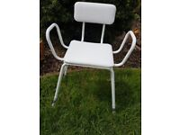 Padded shower chair with arms