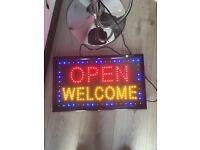 Open Welcome sign