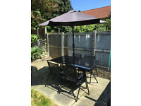 Outside Table and 4 chairs - 1 Year old, very good condition.