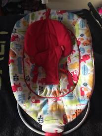 Musical/vibrating baby bouncer