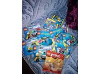 10 packs of unopened lego 5-12 yrs