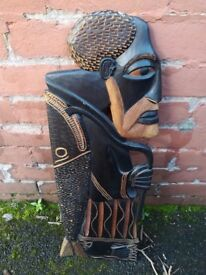 Hand carved African wall plaque depicting a fisherman