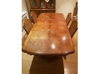 Dining Table with extending feauture & 4 chairs.