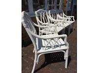 4 White plastic garden chairs
