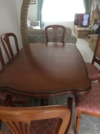 Extendable dining room table and 6 chairs